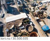 Купить «Top view of the chemical plant and the surrounding area», фото № 30500035, снято 5 марта 2019 г. (c) Яков Филимонов / Фотобанк Лори