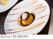 Купить «Sweet dessert cream flan with cream served at plate, nobody», фото № 30500051, снято 22 апреля 2019 г. (c) Яков Филимонов / Фотобанк Лори