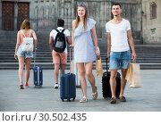 Купить «Positive couple in shorts with luggage», фото № 30502435, снято 22 июня 2017 г. (c) Яков Филимонов / Фотобанк Лори
