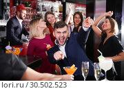 Купить «Guy expressively dancing in bar», фото № 30502523, снято 29 ноября 2017 г. (c) Яков Филимонов / Фотобанк Лори
