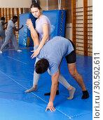 Купить «People practicing self defense techniques», фото № 30502611, снято 31 октября 2018 г. (c) Яков Филимонов / Фотобанк Лори