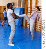 Купить «People practicing self defense techniques», фото № 30502635, снято 31 октября 2018 г. (c) Яков Филимонов / Фотобанк Лори