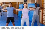 Купить «People warming up at gym», фото № 30502643, снято 31 октября 2018 г. (c) Яков Филимонов / Фотобанк Лори