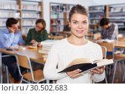 Купить «female student browsing textbooks in university library», фото № 30502683, снято 14 ноября 2018 г. (c) Яков Филимонов / Фотобанк Лори