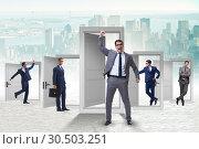 Купить «Businessman in uncertainty concept with many doors», фото № 30503251, снято 18 июня 2019 г. (c) Elnur / Фотобанк Лори