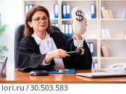 Купить «Middle-aged female doctor working in courthouse», фото № 30503583, снято 4 декабря 2018 г. (c) Elnur / Фотобанк Лори