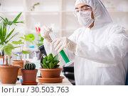 Купить «Biotechnology chemist working in lab», фото № 30503763, снято 5 декабря 2018 г. (c) Elnur / Фотобанк Лори