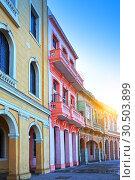 Купить «Bright houses on the street of old Havana, Cuba», фото № 30503899, снято 29 января 2013 г. (c) Куликов Константин / Фотобанк Лори