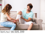 Купить «Young family helping each other after injury», фото № 30505399, снято 21 сентября 2018 г. (c) Elnur / Фотобанк Лори
