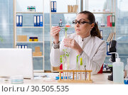 Купить «Female biotechnology scientist chemist working in the lab», фото № 30505535, снято 22 ноября 2018 г. (c) Elnur / Фотобанк Лори
