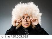 Купить «Young man wearing afro wig», фото № 30505683, снято 15 июня 2014 г. (c) Elnur / Фотобанк Лори