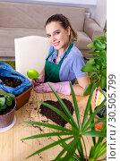 Купить «Young female gardener with plants indoors», фото № 30505799, снято 26 ноября 2018 г. (c) Elnur / Фотобанк Лори
