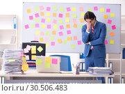 Купить «Young male handsome employee in conflicting priorities concept», фото № 30506483, снято 7 января 2019 г. (c) Elnur / Фотобанк Лори