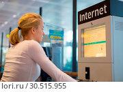 Купить «Woman public internet access point on airport.», фото № 30515955, снято 17 июля 2019 г. (c) easy Fotostock / Фотобанк Лори