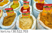 Купить «Russia, Samara, March 2017: Packages with spicy spices from Abkhazia at the fair. Text in Russian: Oriental spices. Coriander Ginger Cinnamon Tomato», фото № 30522703, снято 19 марта 2017 г. (c) Акиньшин Владимир / Фотобанк Лори