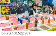 Купить «Russia, Samara, March 2017: A woman sells Siberian honey at a fair. The text in Russian: Acacia linden mountain linseed oil», фото № 30522707, снято 19 марта 2017 г. (c) Акиньшин Владимир / Фотобанк Лори