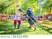 Купить «Russia, Samara, September 2018: Spectacular staged battles of Slavic warriors and knights at the festival in Zagorodny Park.», фото № 30522855, снято 16 сентября 2018 г. (c) Акиньшин Владимир / Фотобанк Лори
