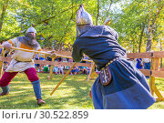 Купить «Russia, Samara, September 2018: Spectacular staged battles of Slavic warriors and knights at the festival in Zagorodny Park.», фото № 30522859, снято 16 сентября 2018 г. (c) Акиньшин Владимир / Фотобанк Лори