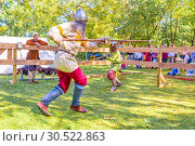 Купить «Russia, Samara, September 2018: Spectacular staged battles of Slavic warriors and knights at the festival in Zagorodny Park.», фото № 30522863, снято 16 сентября 2018 г. (c) Акиньшин Владимир / Фотобанк Лори