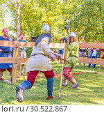 Купить «Russia, Samara, September 2018: Spectacular staged battles of Slavic warriors and knights at the festival in Zagorodny Park.», фото № 30522867, снято 16 сентября 2018 г. (c) Акиньшин Владимир / Фотобанк Лори