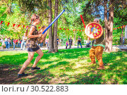 Купить «Russia, Samara, September 2018: Spectacular staged battles of Slavic warriors and knights at the festival in Zagorodny Park.», фото № 30522883, снято 16 сентября 2018 г. (c) Акиньшин Владимир / Фотобанк Лори