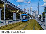 Купить «Москва, современный трамвай у ВДНХ», фото № 30526523, снято 17 сентября 2018 г. (c) glokaya_kuzdra / Фотобанк Лори