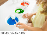 Купить «girl coloring easter eggs by liquid dye at home», фото № 30527107, снято 25 июля 2018 г. (c) Syda Productions / Фотобанк Лори