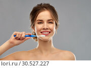 Купить «smiling woman with toothbrush cleaning teeth», фото № 30527227, снято 20 января 2019 г. (c) Syda Productions / Фотобанк Лори