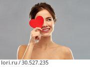Купить «beautiful smiling woman holding red heart», фото № 30527235, снято 20 января 2019 г. (c) Syda Productions / Фотобанк Лори