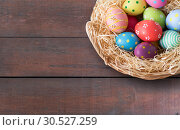 Купить «close up of colored easter eggs in basket», фото № 30527259, снято 15 марта 2018 г. (c) Syda Productions / Фотобанк Лори