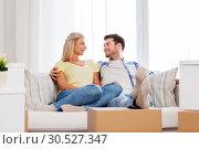 Купить «happy couple with boxes moving to new home», фото № 30527347, снято 25 февраля 2016 г. (c) Syda Productions / Фотобанк Лори