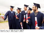 Купить «happy students in mortar boards with diplomas», фото № 30527387, снято 24 сентября 2016 г. (c) Syda Productions / Фотобанк Лори