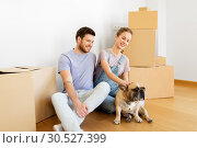 Купить «happy couple with boxes and dog moving to new home», фото № 30527399, снято 4 июня 2017 г. (c) Syda Productions / Фотобанк Лори