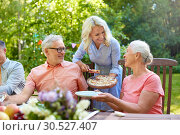 Купить «happy family having dinner or summer garden party», фото № 30527407, снято 9 июля 2017 г. (c) Syda Productions / Фотобанк Лори