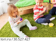 Купить «children with modelling clay or slimes at home», фото № 30527427, снято 15 октября 2017 г. (c) Syda Productions / Фотобанк Лори