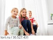 Купить «happy little kids sitting on window sill», фото № 30527431, снято 15 октября 2017 г. (c) Syda Productions / Фотобанк Лори
