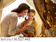 Купить «happy family with smartphone in kids tent at home», фото № 30527443, снято 27 января 2018 г. (c) Syda Productions / Фотобанк Лори