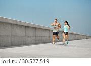 Купить «couple in sports clothes running outdoors», фото № 30527519, снято 1 августа 2018 г. (c) Syda Productions / Фотобанк Лори