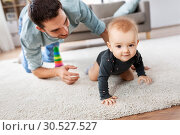 Купить «happy little baby girl with father at home», фото № 30527527, снято 25 августа 2018 г. (c) Syda Productions / Фотобанк Лори
