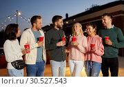Купить «friends with drinks at rooftop party», фото № 30527543, снято 2 сентября 2018 г. (c) Syda Productions / Фотобанк Лори