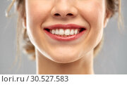 Купить «close up of smiling woman face with white teeth», фото № 30527583, снято 20 января 2019 г. (c) Syda Productions / Фотобанк Лори