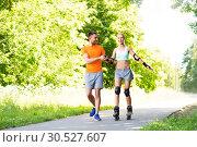 Купить «couple with roller skates riding in summer park», фото № 30527607, снято 5 июля 2015 г. (c) Syda Productions / Фотобанк Лори
