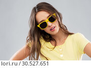 Купить «teenage girl in yellow sunglasses and t-shirt», фото № 30527651, снято 29 января 2019 г. (c) Syda Productions / Фотобанк Лори