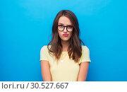 Купить «frowning young woman or teenage girl in glasses», фото № 30527667, снято 29 января 2019 г. (c) Syda Productions / Фотобанк Лори