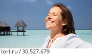 Купить «happy woman over beach and bungalow on background», фото № 30527679, снято 15 июня 2018 г. (c) Syda Productions / Фотобанк Лори