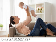 Купить «happy mother playing with little baby boy at home», фото № 30527727, снято 1 сентября 2017 г. (c) Syda Productions / Фотобанк Лори