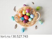 Купить «colored easter eggs in basket», фото № 30527743, снято 15 марта 2018 г. (c) Syda Productions / Фотобанк Лори