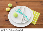 Купить «easter egg in cup holder, plates and cutlery», фото № 30527751, снято 15 марта 2018 г. (c) Syda Productions / Фотобанк Лори