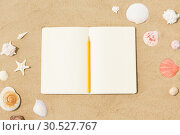Купить «notebook with pencil and seashells on beach sand», фото № 30527767, снято 27 июня 2018 г. (c) Syda Productions / Фотобанк Лори