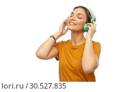 Купить «happy young woman or teenage girl with headphones», фото № 30527835, снято 10 ноября 2018 г. (c) Syda Productions / Фотобанк Лори